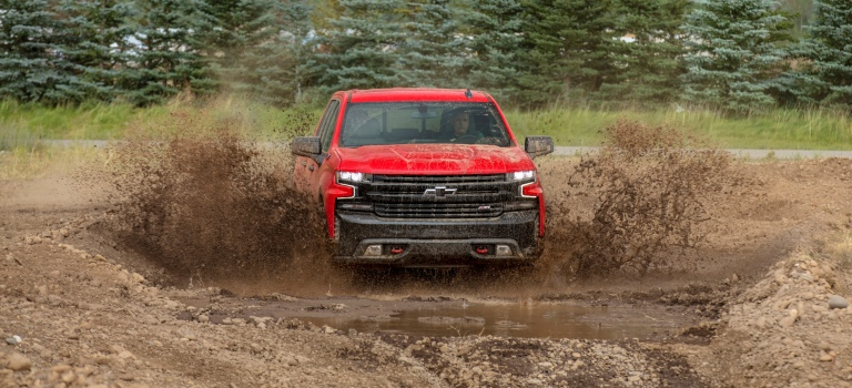 2019 Chevy Silverado red in the mud front view