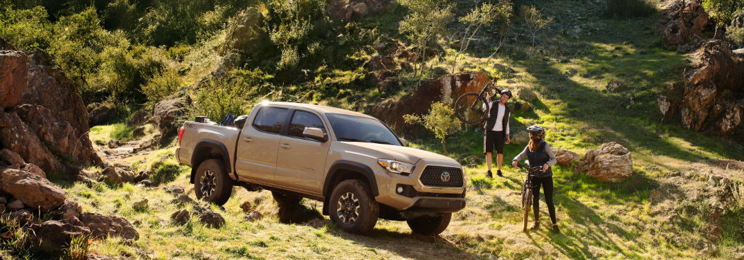 2019 Toyota Tacoma TRD Performance Specs with image of 2019 Tacoma TRD Off-Road in valley with bikers