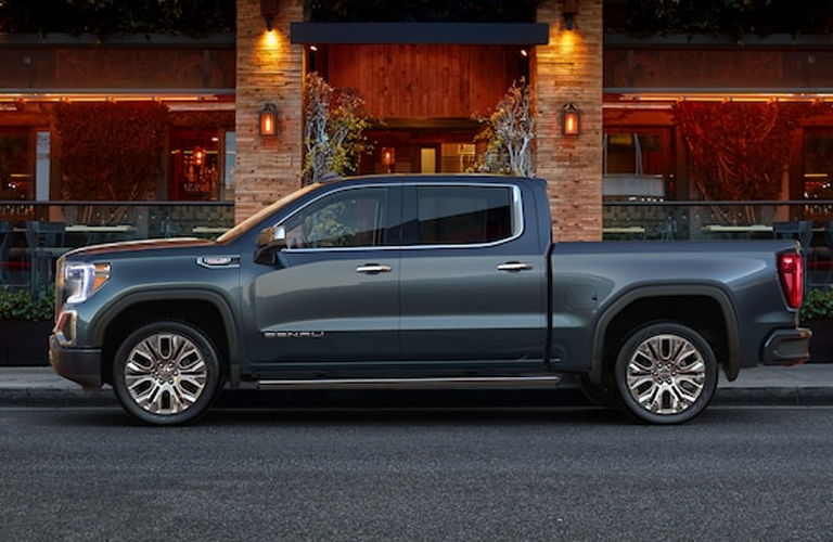 Exterior view of a gray 2019 GMC Sierra 1500 parked on a city street