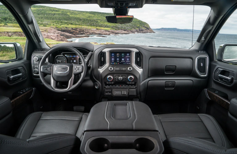 Interior view of black seating and steering wheel & dashboard of a 2019 GMC Sierra 1500